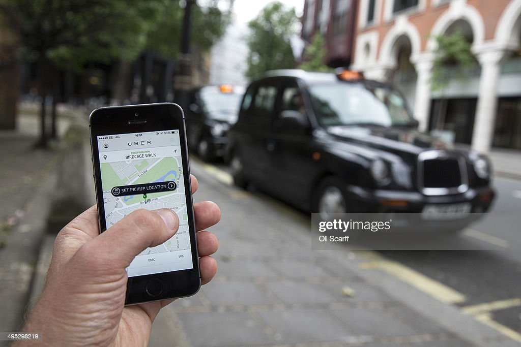 In this photo illustration, a smartphone displays the 'Uber' mobile application which allows users to hail private-hire cars from any location on June 2, 2014 in London, England. The controversial piece of software, which is opposed by established taxi drivers, currently serves more than 100 cities in 37 countries. London's black cabs are seeking a High Court ruling on the claim that the Uber software is breaking the law by using an app as a taxi meter to determine rates.