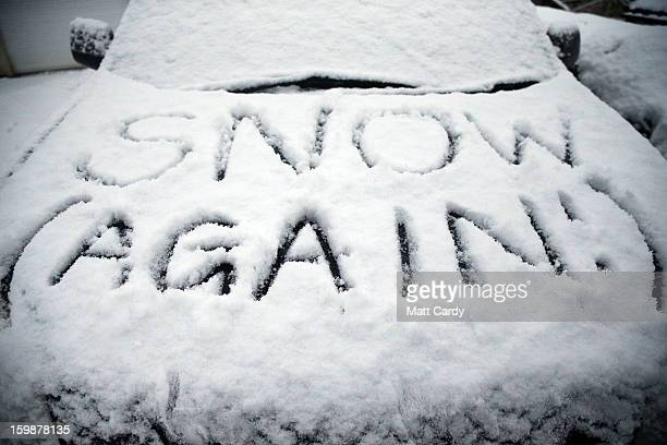 In this photo illustration a snow covered car is seen in Holcombe on January 22 2013 in Somerset England Snow and ice is continuing to cause...