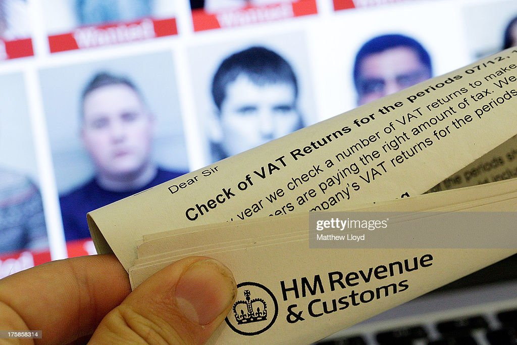 In this photo illustration a tax document is seen in front of a laptop screen showing the HMRC Flickr feed with the faces of their most wanted tax evaders on August 9, 2013 in London, United Kingdom. So far only one of the original 20 published individuals has been apprehended.
