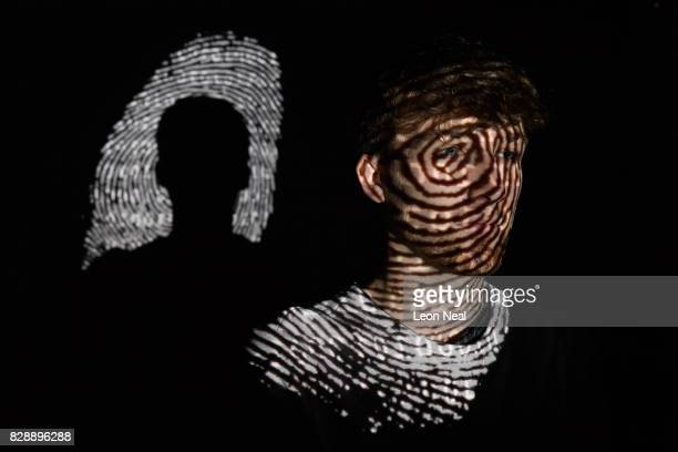 In this photo illustration a thumbprint is projected onto a man on August 09 2017 in London England With so many areas of modern life requiring...