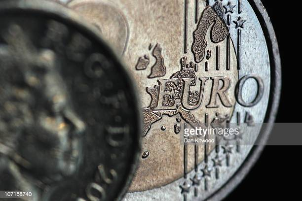 In this photo illustration a two Euro coin and a GBP1 coin are displayed on November 26 2010 in London England Concerns over the Euro zone debts have...