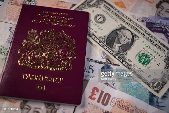 In this photo illustration a UK passport is seen besides US Dollar bills and Pound Sterling notes on January 17 2017 in Bristol England Sterling has...