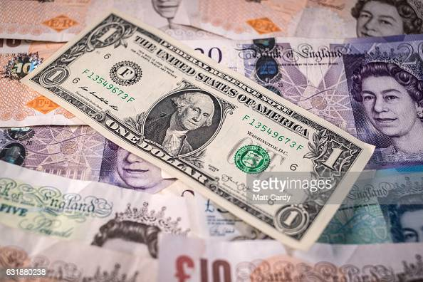 In this photo illustration a US Dollar bills is seen besides Pound Sterling notes on January 17 2017 in Bristol England Sterling has dropped sharply...
