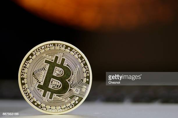 In this photo illustration a visual representation of the digital Cryptocurrency Bitcoin in front of a Bitcoin chart is displayed on November 30 2017...