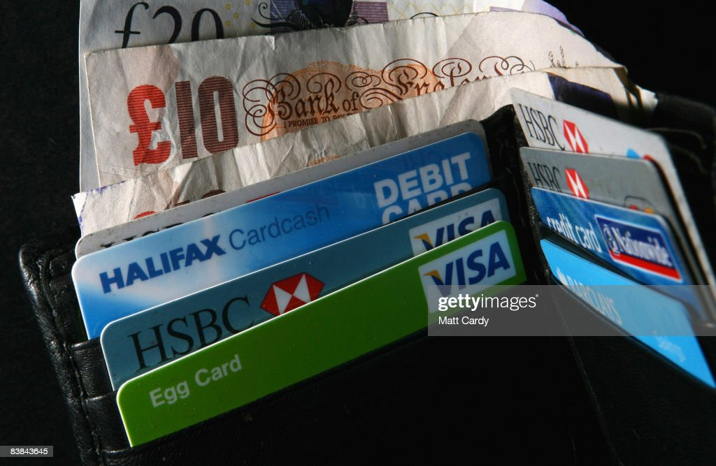 In this photo illustration a wallet open to show credit cards and cash on November 27 2008 in Bristol, England. Many UK consumers are feeling the pinch as the financial crisis and economic downturn makes borrowing harder and more expensive and the recession starts to bite.