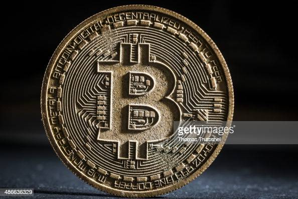 In this photo illustration a weathered model Bitcoin stands on a table on April 25 2014 in Berlin Germany