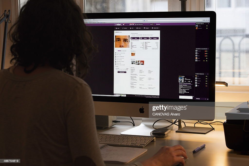 In this photo illustration a woman browses at a pecialized adultery website on screen on January 24, 2014 in France.