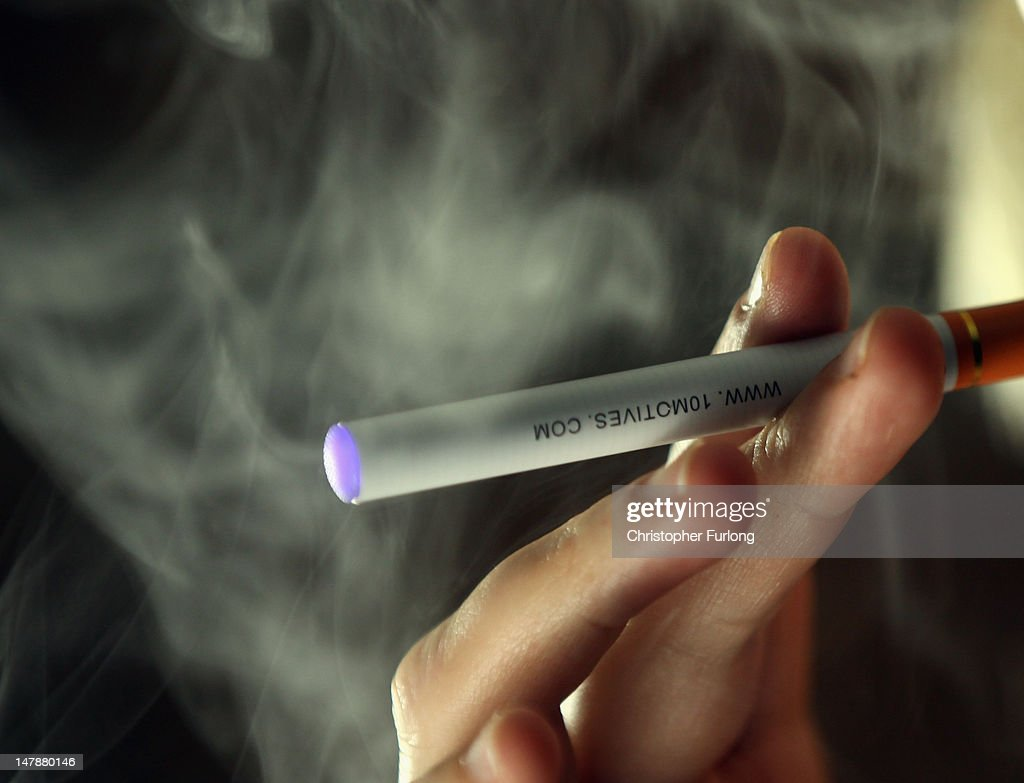 In this photo illustration a woman smokes an electronic cigarette on July 5, 2012 in Knutsford, United Kingdom. Electronic cigarettes are the latest health device for smokers hoping to quit nicotine addiction. Earlier today a major security operation took place in Staffordshire, England, after a passenger on a coach used an electronic cigarette which was mistaken for something more sinister and a full scale security alert was instigated. The 48 passengers were later allowed to carry on with their journey.