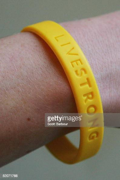 In this photo illustration a yellow band which represents the Lance Armstrong Foundation LiveStrong is sported in aid of the charitable event January...