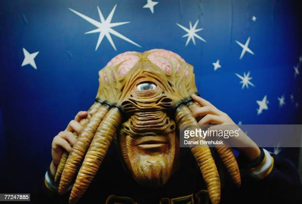 In this photo illustration a young boy wears a Doctor Who Dalek Sec Hybrid Voice Changer Mask during the Dream Toys 2007 Christmas predictions fair...