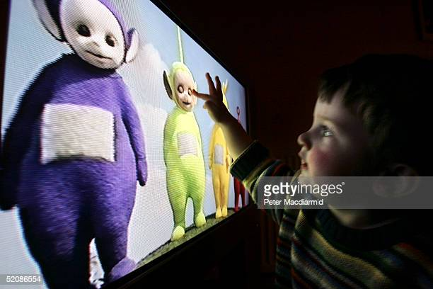 In this photo illustration a young child watches television at home January 27 2005 in London England