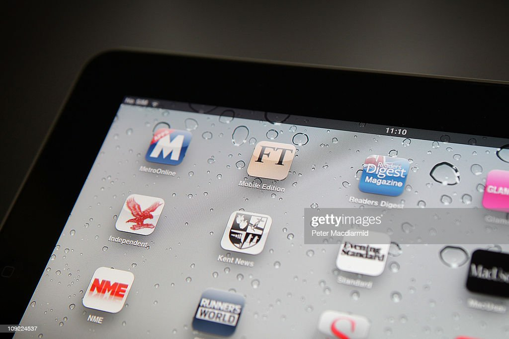 In this photo illustration, an Apple ipad tablet displays newspaper and magazine apps on February 17, 2011 in London, England. Apple sold two million ipads in the first two months of their launch in 2010. Worldwide iPad sales are expected to amount to 20 million in 2012.