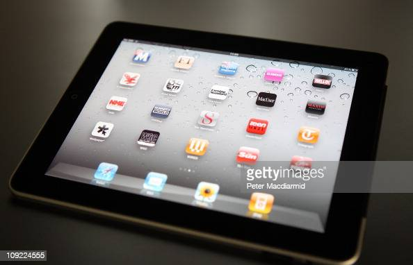 In this photo illustration an Apple ipad tablet displays newspaper and magazine apps on February 17 2011 in London England Apple sold two million...