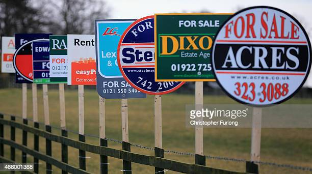 In this photo illustration an array of property For Sale marketing boards are erected at sign manufacturers Real Estate Advertising Ltd on March 11...