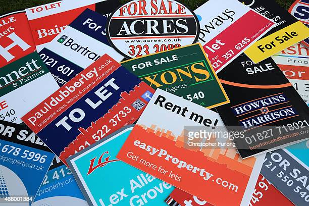 In this photo illustration an array of property For Sale marketing boards lay on the ground at sign manufacturers Real Estate Advertising Ltd on...