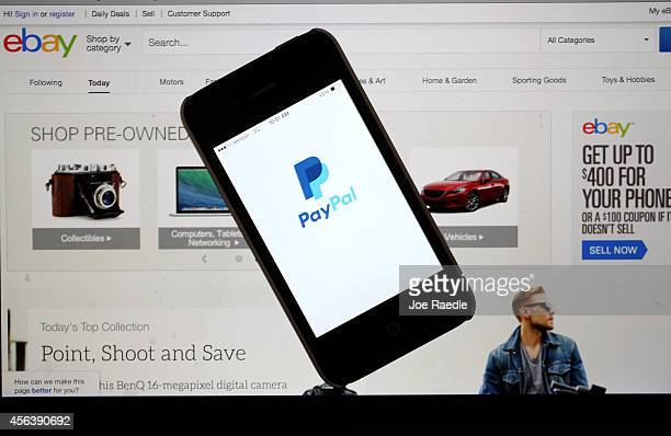 In this photo illustration an eBay website is seen on a computer screen and the PayPal website is seen on an iphone on September 30 2014 in Miami...