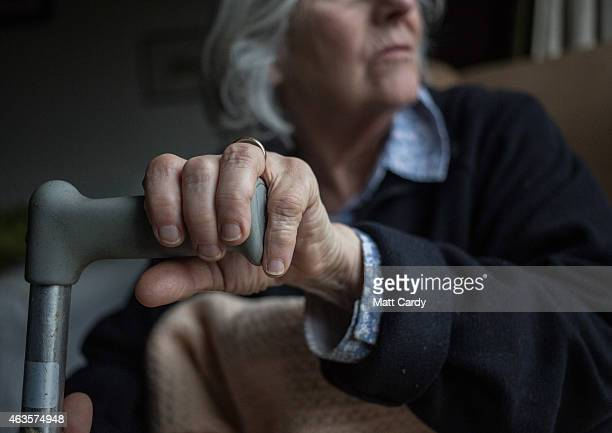 In this photo illustration an elderly person sits in a chair at home on February 16 2015 near Bristol England The issues affecting the elderly along...