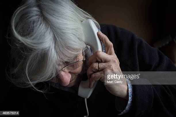 In this photo illustration an elderly person uses a telephone on February 16 2015 near Bristol England The issues affecting the elderly along with...