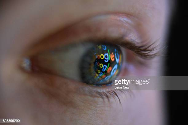 In this photo illustration an image of the Google logo is reflected on the eye of a young man on August 09 2017 in London England Founded in 1995 by...