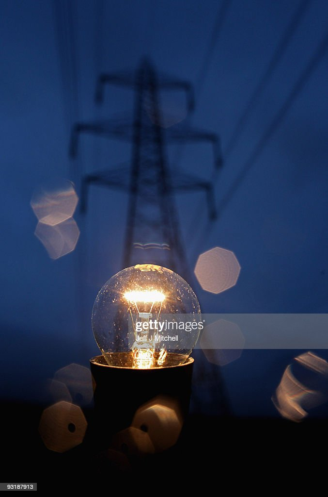 In this photo illustration an incandescent light bulb is illuminated next to electricity pylons on November 18, 2009 in Greenock, Scotland. As world leaders prepare to gather for the Copenhagen Climate Summit in December, the resolve of the industrial nations seems to be weakening with President Obama stating that it would be impossible to reach a binding deal at the summit. Climate campaigners are concerned that this disappointing announcement is a backward step ahead of the summit.