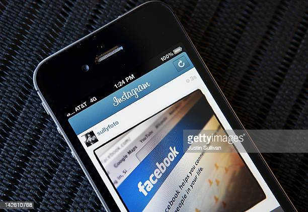 In this photo illustration an Instagram photo of the Facebook website app is seen on an Apple iPhone on April 9 2012 in New York City Facebook Inc is...