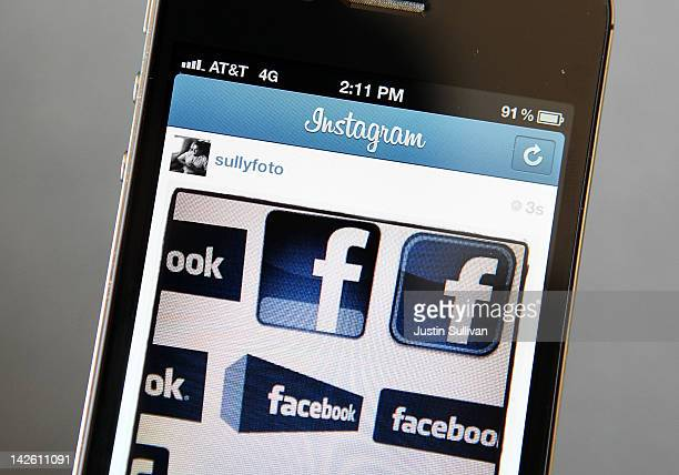 In this photo illustration an Instagram photo of various Facebook logos are seen on an Apple iPhone on April 9 2012 in New York City Facebook Inc is...