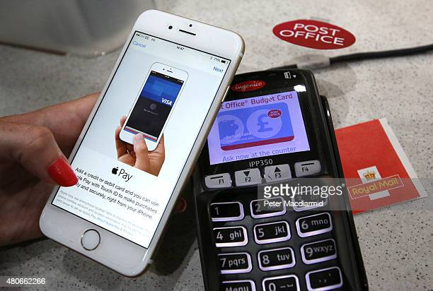 In this photo illustration an iPhone is used to make an Apple Pay purchase at The Post Office on July 14 2015 in London England From today iPhone and...