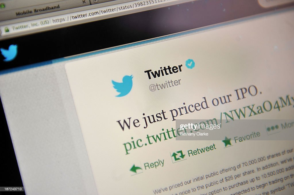 In this photo illustration an online communication from Twitter is displayed on a computer screen announcing the company's initial public offering...