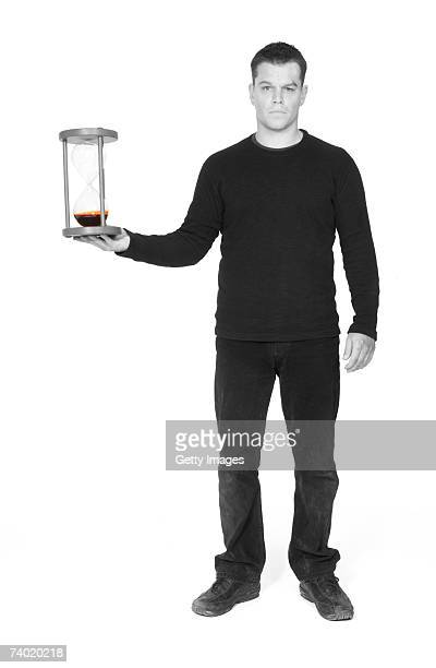 In this photo illustration and handout image Actor Matt Damon holds an hourglass filled with blood on April 26 2007 in London England An...