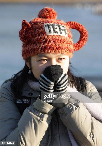 In this photo illustration Annie Cheung warms her hands from the cold temperatures in Hyde Park on January 6 2009 in London England Temperatures in...