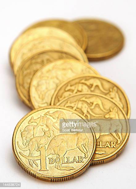 In this photo illustration Australian one dollar coins are displayed on May 16 2012 in Melbourne Australia The Australian dollar is lower after talks...