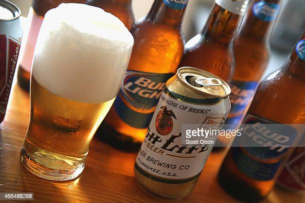 In this photo illustration bottles and cans of beer that are products of SABMiller and AnheuserBusch InBev are shown on September 15 2014 in Chicago...