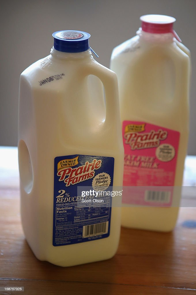 In this photo illustration, bottles of milk sit on a counter on December 27, 2012 in Chicago, Illinois. Milk prices could spike to $6 to $8 a gallon in January if lawmakers fail to reach a 'fiscal cliff' deal and renew a Farm Bill that's been in place since 2008 and sets the price at which the government buys milk.