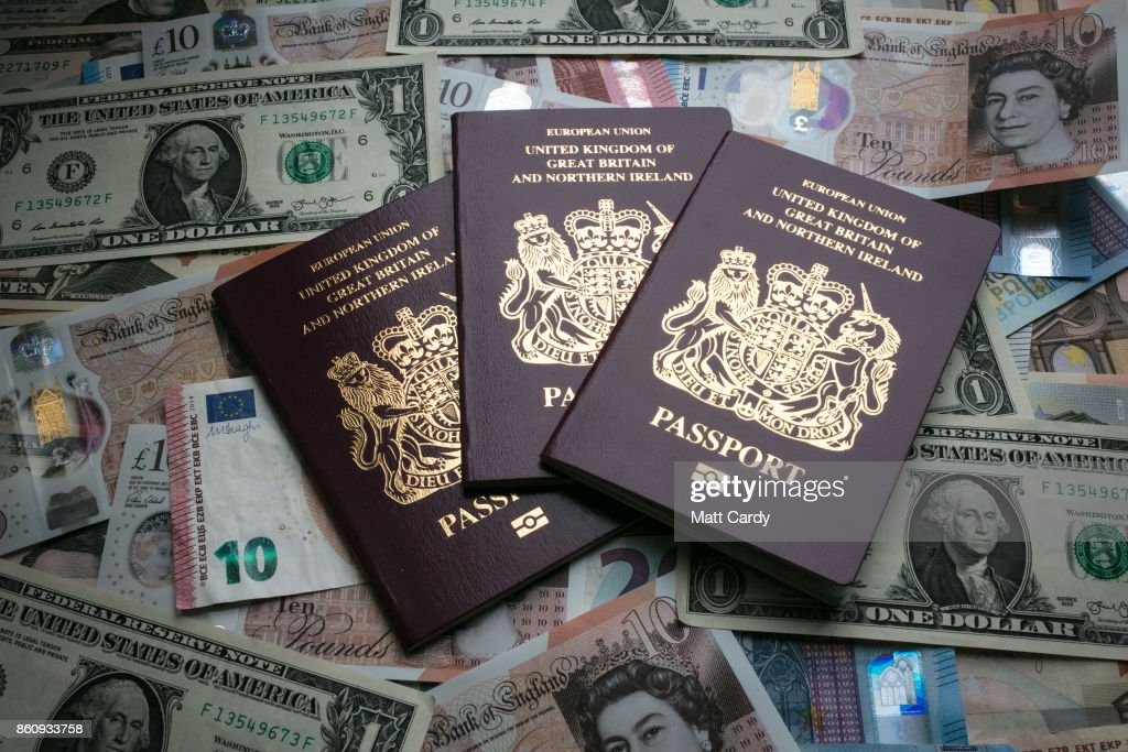 In this photo illustration, British passports are placed on currency including the new £10 note, US dollar bills and euro notes on October 13, 2017 in Bath, England. Currency experts have warned that as the uncertainty surrounding Brexit continues, the value of the British pound, which has remained depressed against the US dollar and the euro since the UK voted to leave in the EU referendum, is likely to fluctuate.