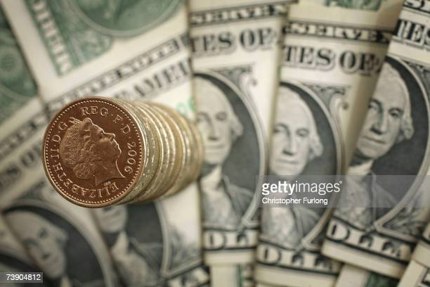 In this photo illustration British pound coins can be seen next to American Dollar notes on April 17 2007 in Manchester England The British pound has...