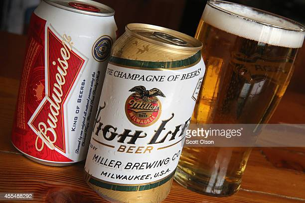 In this photo illustration cans of Miller High Life and Budweiser beer that are products of SABMiller and AnheuserBusch InBev are shown on September...