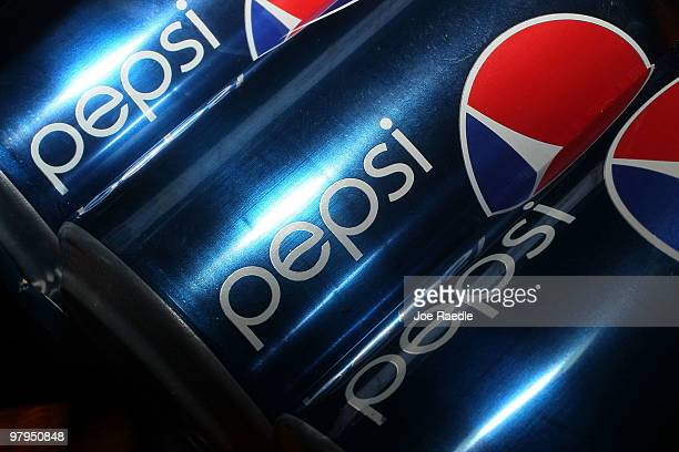 In this photo illustration cans of Pepsi sodas are seen on March 22 2010 in Miami Florida PepsiCo announced plans to cut sugar fat and sodium in its...