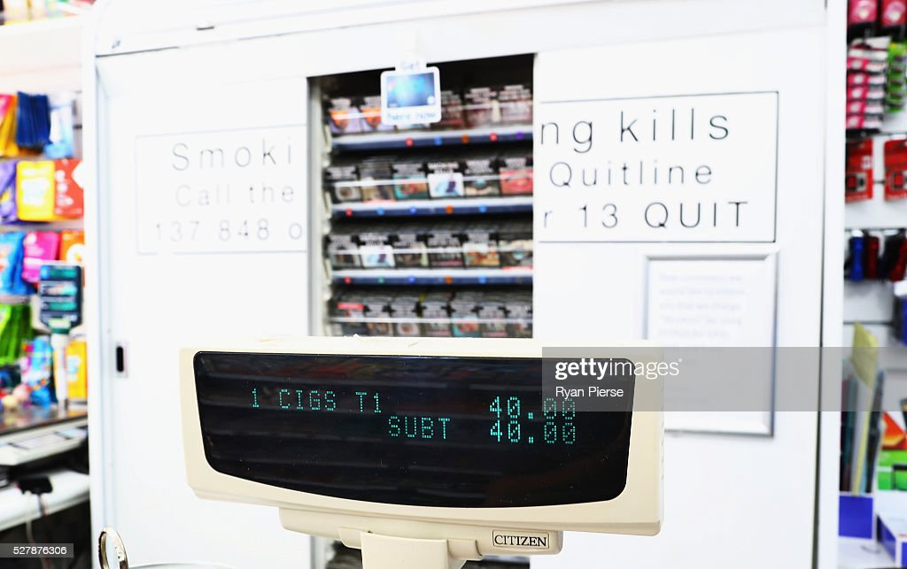 In this photo illustration cigarettes are seen on the shelf behind a cash register on May 04, 2016 in Sydney, New South Wales. The Australian Government yesterday announced in their budget four annual 12.5 per cent increases to tobacco excise and excise equivalent customs duties which will significantly push up the over-the counter price up to AUD$40 by 2020.