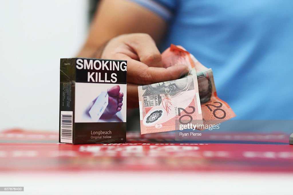 In this photo illustration cigarettes are seen with Australian currency on May 04, 2016 in Sydney, New South Wales. The Australian Government yesterday announced in their budget four annual 12.5 per cent increases to tobacco excise and excise equivalent customs duties which will significantly push up the over-the counter price up to AUD$40 by 2020.