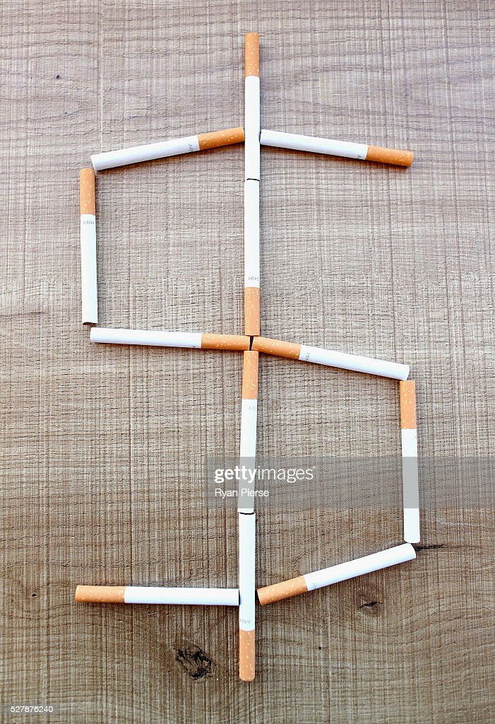 In this photo illustration cigarettes form a dollar sign on May 04, 2016 in Sydney, New South Wales. The Australian Government yesterday announced in their budget four annual 12.5 per cent increases to tobacco excise and excise equivalent customs duties which will significantly push up the over-the counter price up to AUD$40 by 2020.