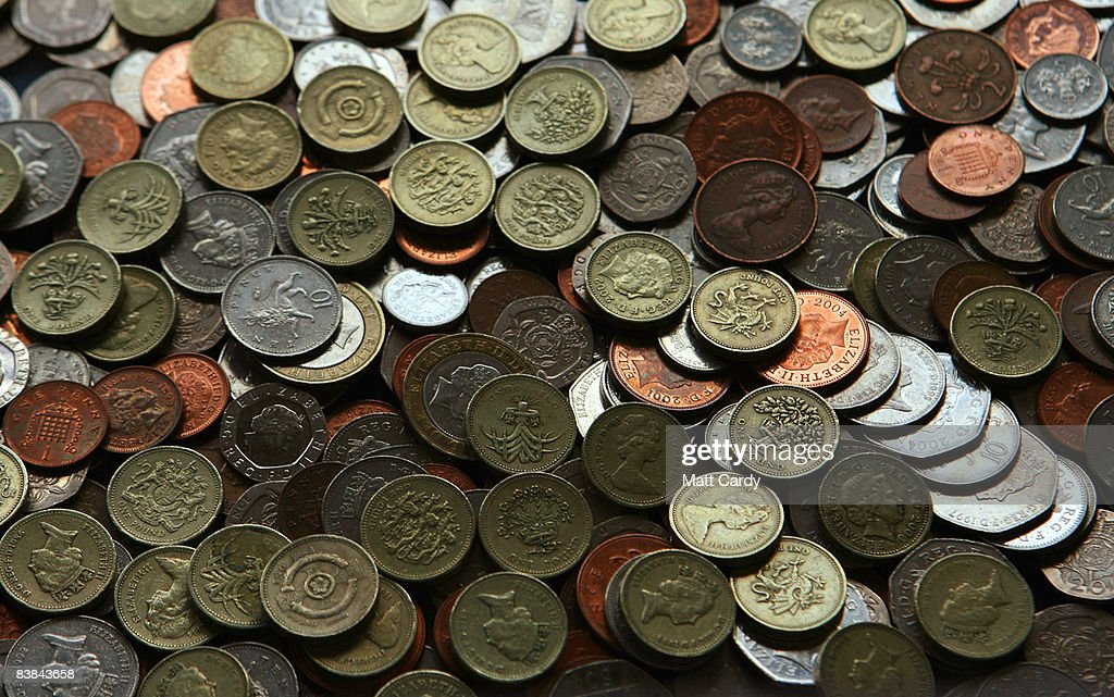 In this photo illustration coins are scattered on a table on November 27 2008 in Bristol, England. Many UK consumers are feeling the pinch as the financial crisis and economic downturn makes borrowing harder and more expensive and the recession starts to bite.