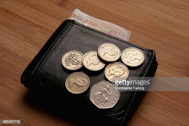 In this photo illustration coins to the value of GBP 650 the equivalent to the future UK minimum wage sit on a wallet on May 20 2014 in Knutsford...