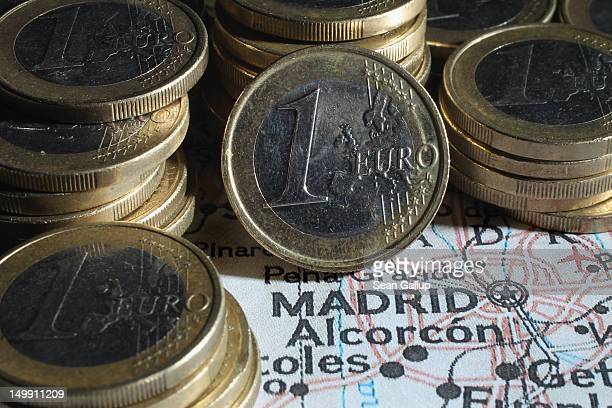 In this photo illustration columns of one Euro coins stand on a map of Spain next to Madrid on August 6 2012 in Berlin Germany The Spanish government...