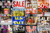 In this photo illustration composed of multiple images sale signs sit in various store windows in New York US on Tuesday March 17 2009 While new...
