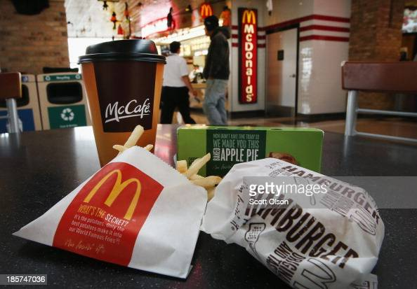 In this photo illustration customers order food from a McDonald's restaurant on October 24 2013 in Des Plaines Illinois McDonald's has announced it...