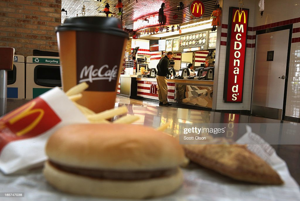 In this photo illustration, Customers order food from a McDonald's restaurant on October 24, 2013 in Des Plaines, Illinois. McDonald's has announced it will make changes to its low-priced Dollar Menu, which includes items like coffee, small fries, hamburgers and apple pies. The new menu, dubbed the Dollar Menu and More, will offer some higher priced options such as the grilled Onion Cheddar Burger and a McChicken sandwich.