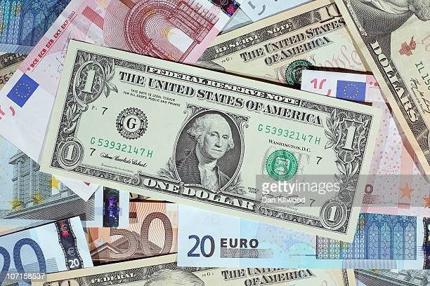 In this photo illustration Dollar and Euro notes are displayed on November 26 2010 in London England Concerns over the Euro zone debts have caused...