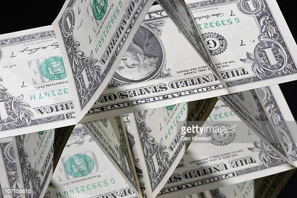 In this photo illustration Dollar notes are displayed in a pyramid on November 26 2010 in London England Concerns over the Euro zone debts have...