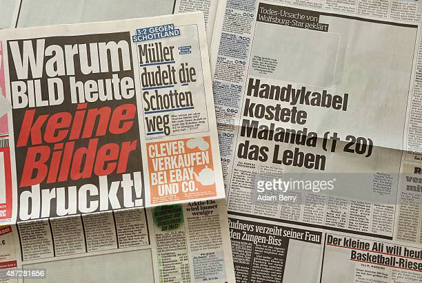 In this photo illustration editions of the Bild newspaper printed without any pictures are seen on the paper's publication day September 8 in Berlin...