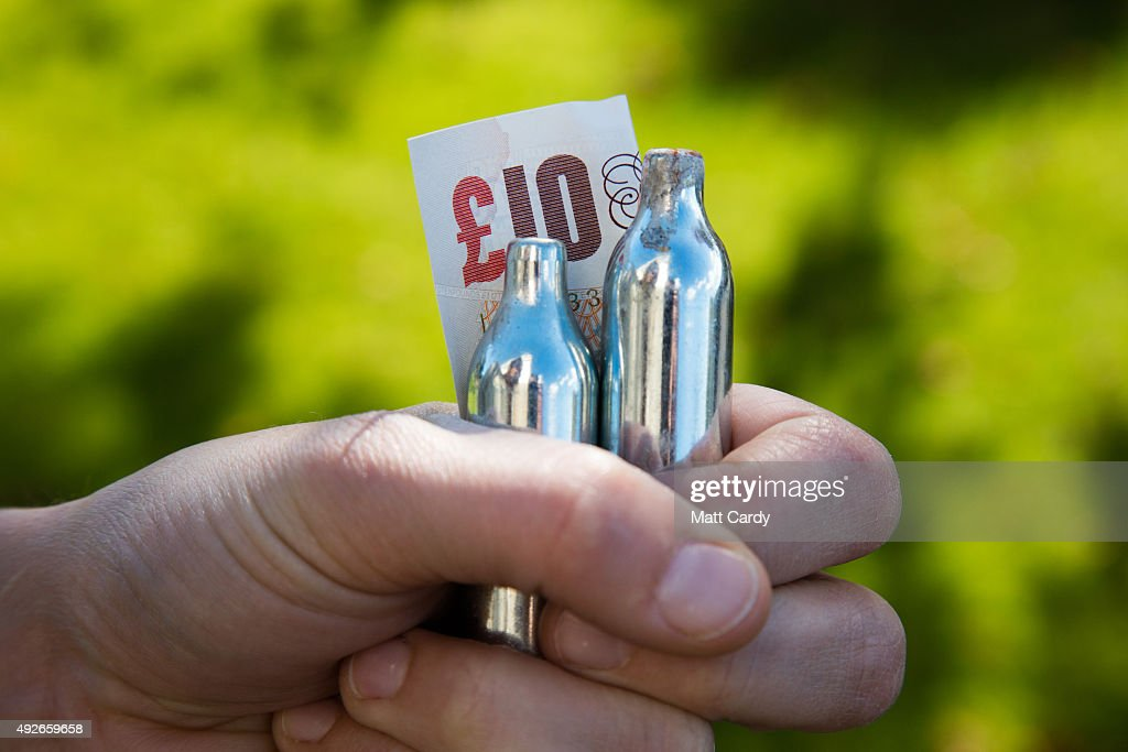 In this photo illustration empty canisters of nitrous oxide are seen on October 14 2015 in Bristol England The UK government is moving towards the...